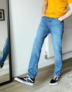 Blå medium forvaskedeslimfit-jeans fra ASOS DESIGN
